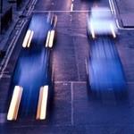 Visual: cars speeding along a road
