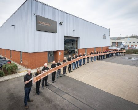 Trackwise staff show the 26m-long flexible PCB for a UAV